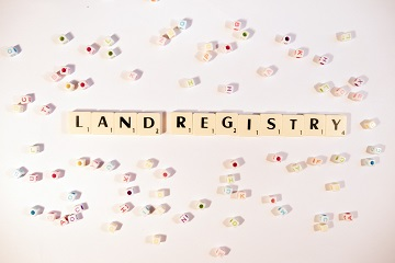 Land registry written in scrabble tiles