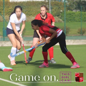 Image showing 3 girls playing hockey, with the words: 'Game on - this girl can.'