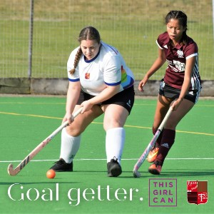 Image showing 2 girls playing hockey, with the words: 'Goal getter - this girl can.'
